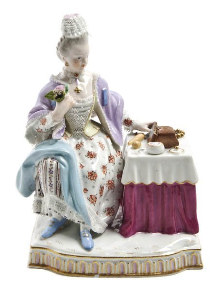 560: A Meissen Porcelain Lace Figure, Height 4 inches.