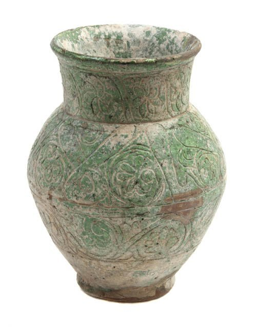 1039: A Middle Eastern Pottery Vase, Height 6 3/8 inche