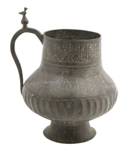 1049: A Middle Eastern Metal Vessel, Height 7 3/4 inche