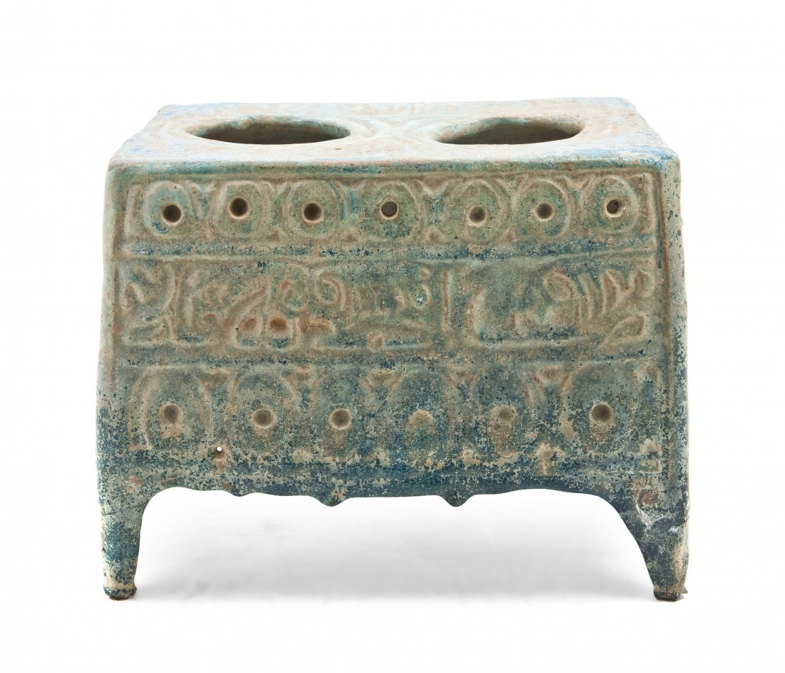 1052: A Middle Eastern Turquoise Glaze Pottery Inkwell,