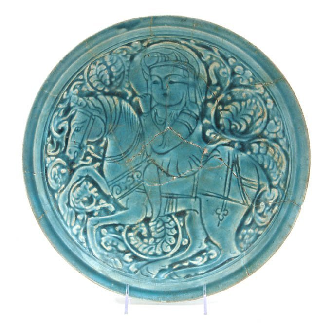 1053: A Middle Eastern Turquoise Glaze Pottery Charger,