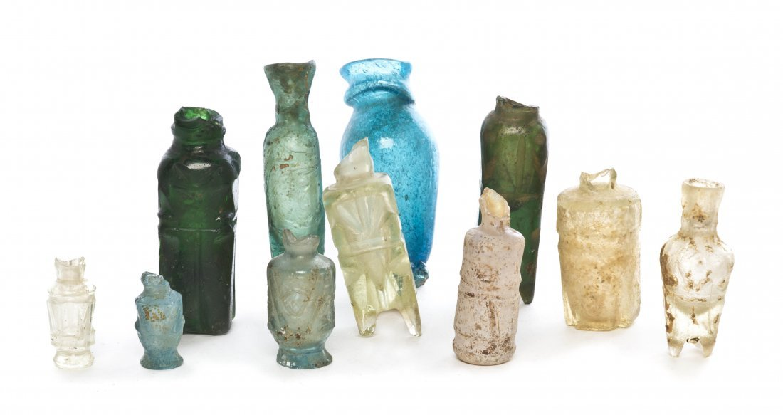 1062: A Collection of Eleven Glass Bottles, Height of t
