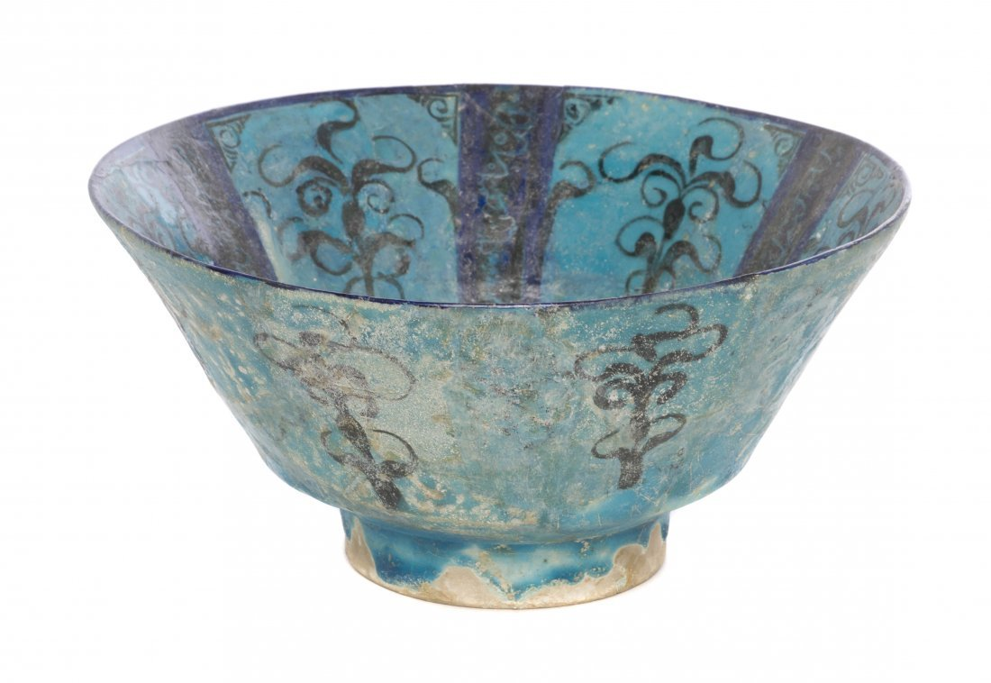 1066: A Kashan Pottery Bowl, Diameter 8 3/8 inches.
