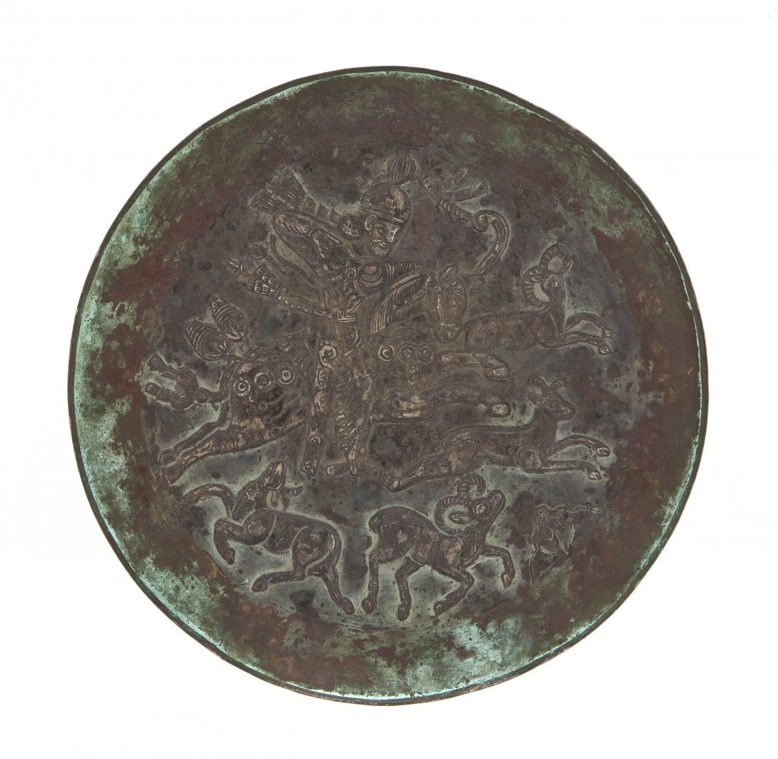 1069: A Sassanian Silver Plate, Diameter 7 7/8 inches.