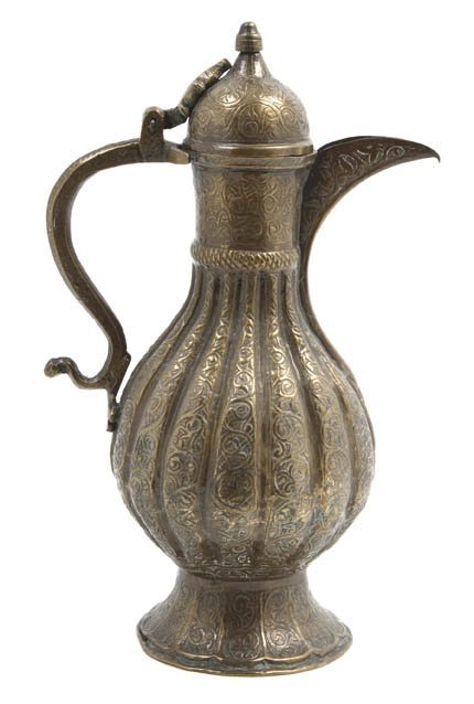 1071: An Indian Gilt Metal Ewer, Height 11 inches.