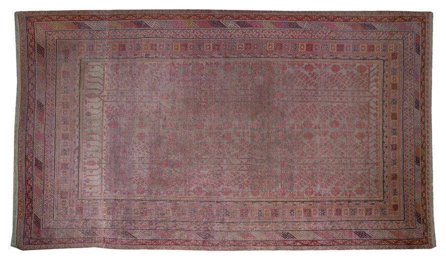1105: An Agra Wool Rug, 9 feet x 14 feet 8 inches.