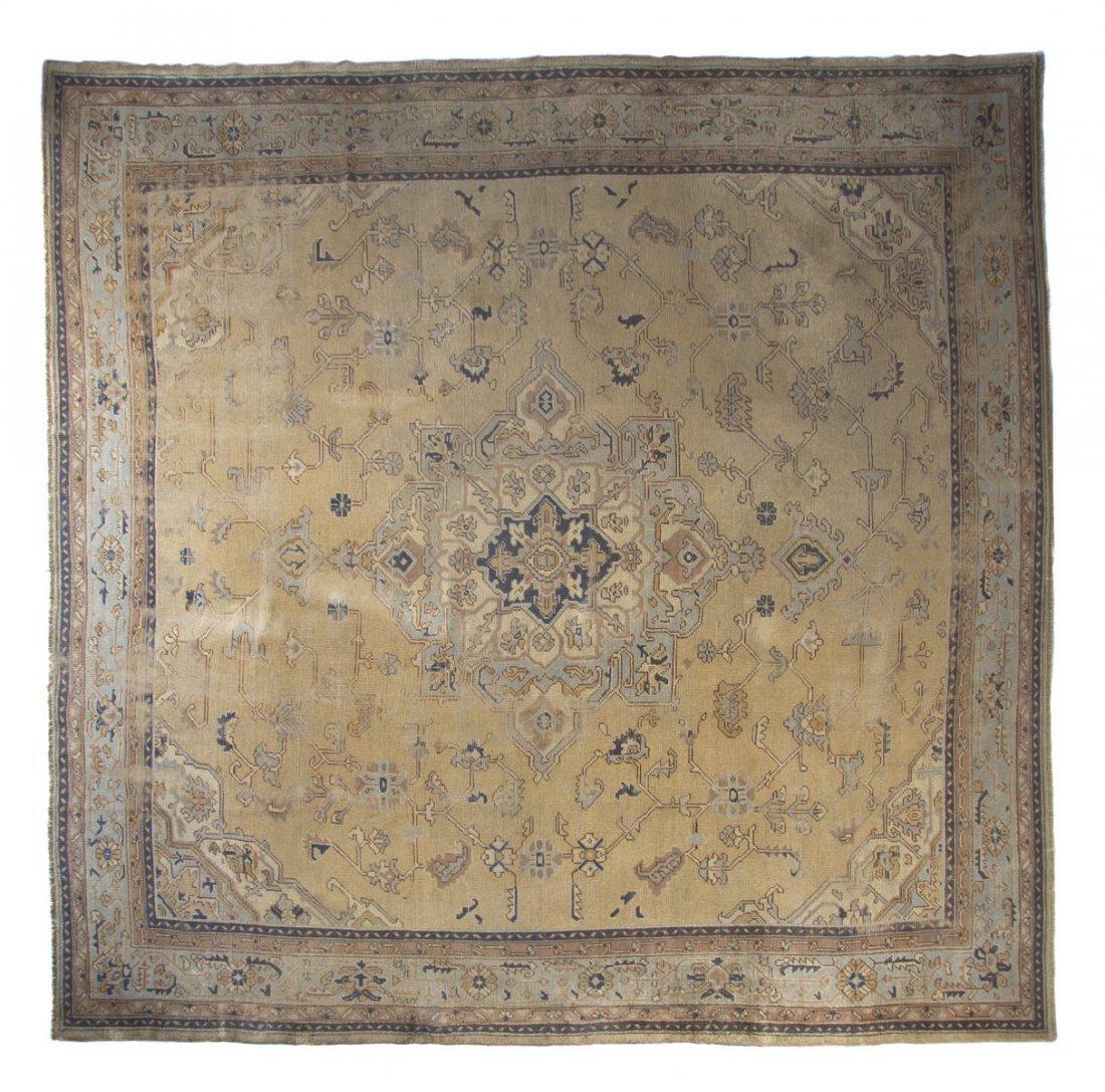 1134: An Oushak Wool Rug, 10 feet x 12 feet 4 inches.