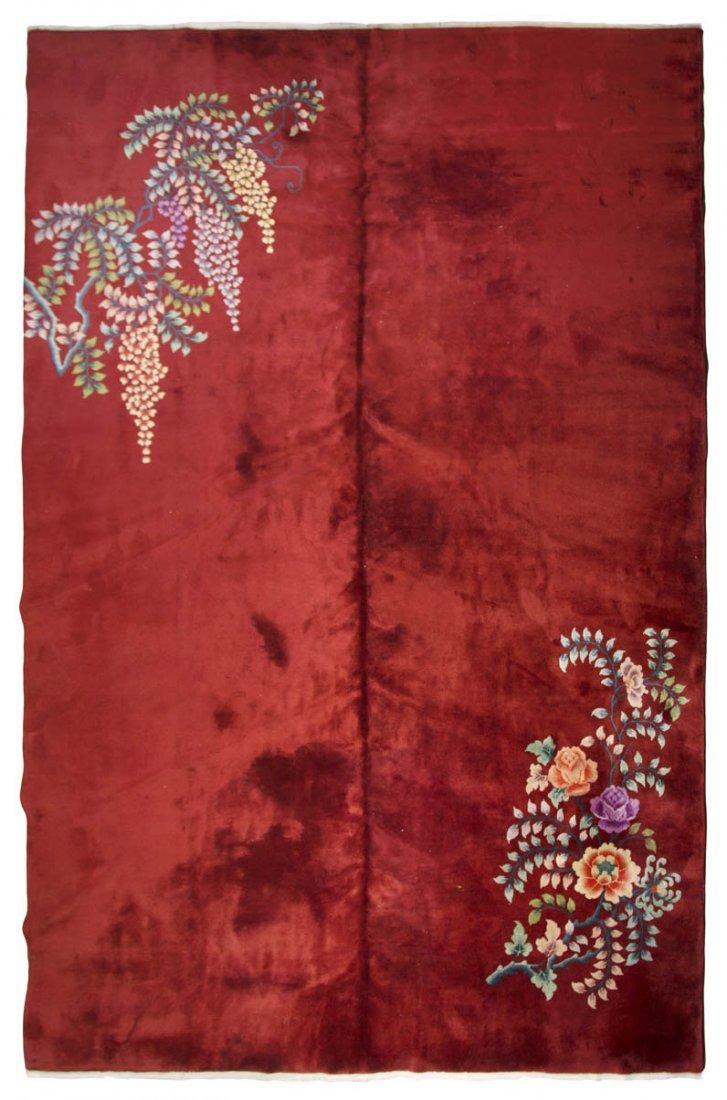 1137: A Chinese Wool Rug, 13 feet 6 inches x 9 feet 11