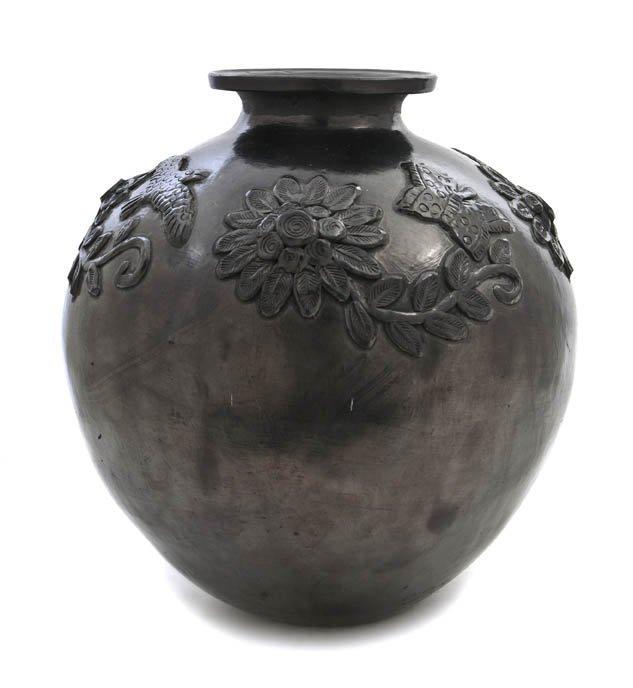 1143: A Dona Rosa Blackware Vase, Height 14 3/4 inches.
