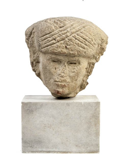 1144: An Aztec Limestone Bust, Height 11 inches.