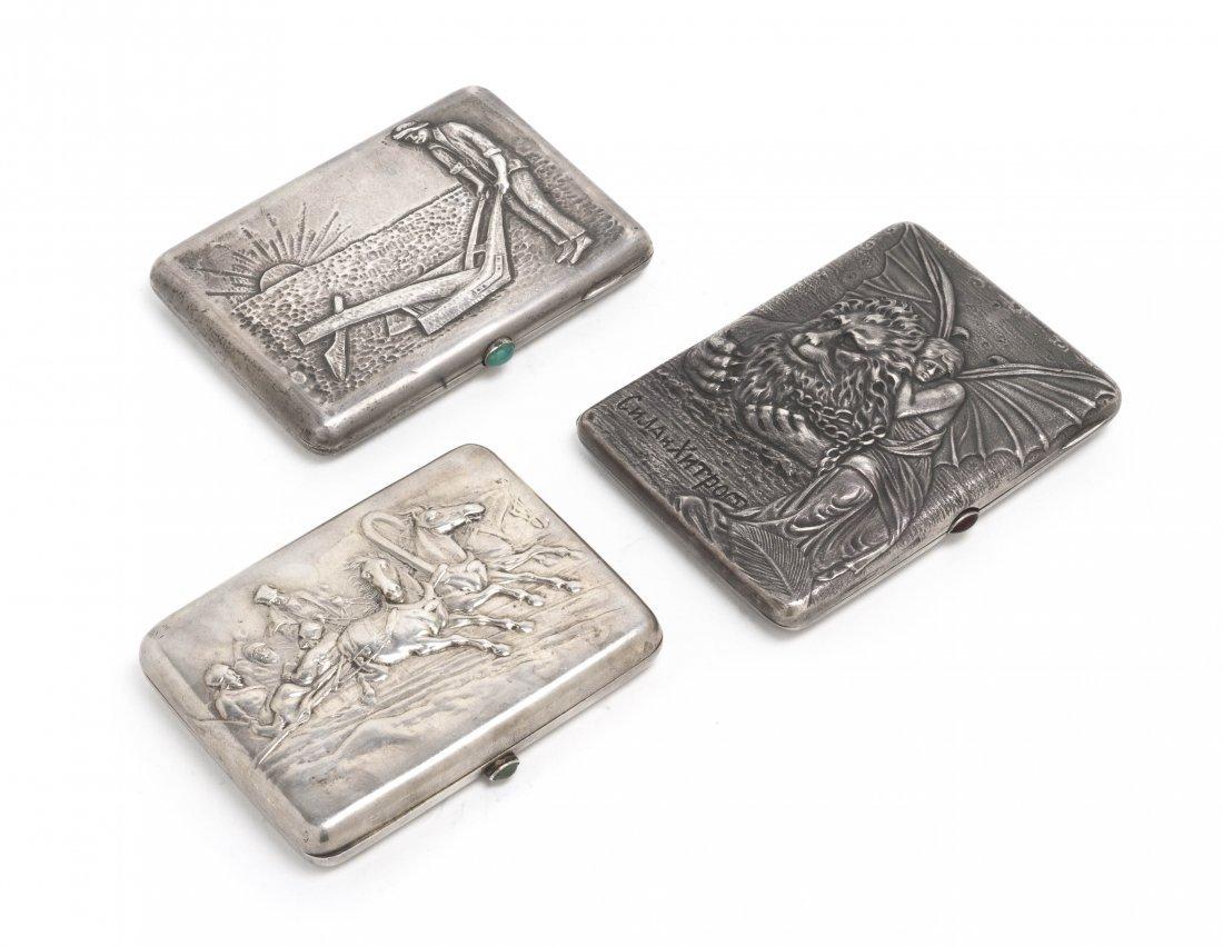 1285: A Collection of Three Russian Silver Cigarette Ca