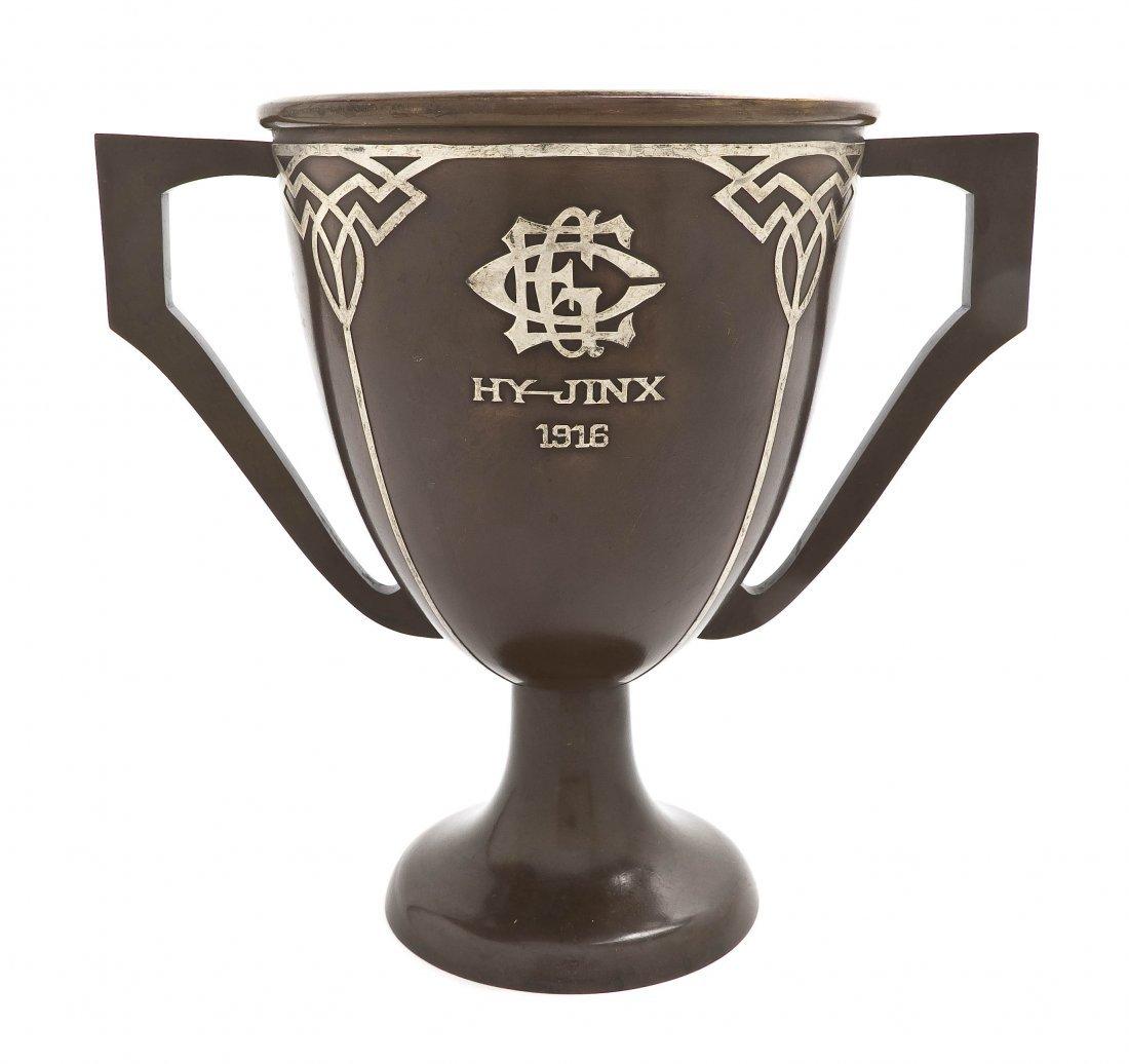 1455: A Heintz Silver Overlay Bronze Trophy, Height 10