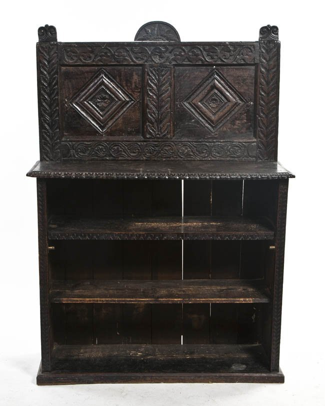 2135: A Continental Carved Oak Bookcase, Height 55 1/4