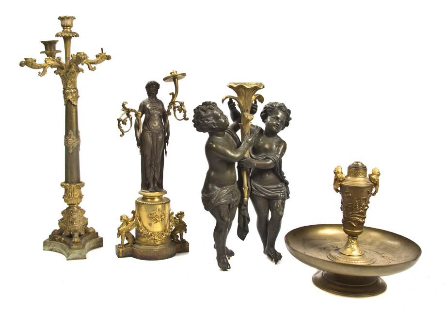 2318: A Collection of Bronze and Gilt Metal Candelabra