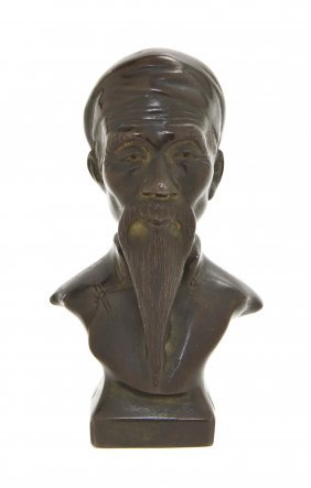 A Chinese Bronze Bust, Height 4 Inches.