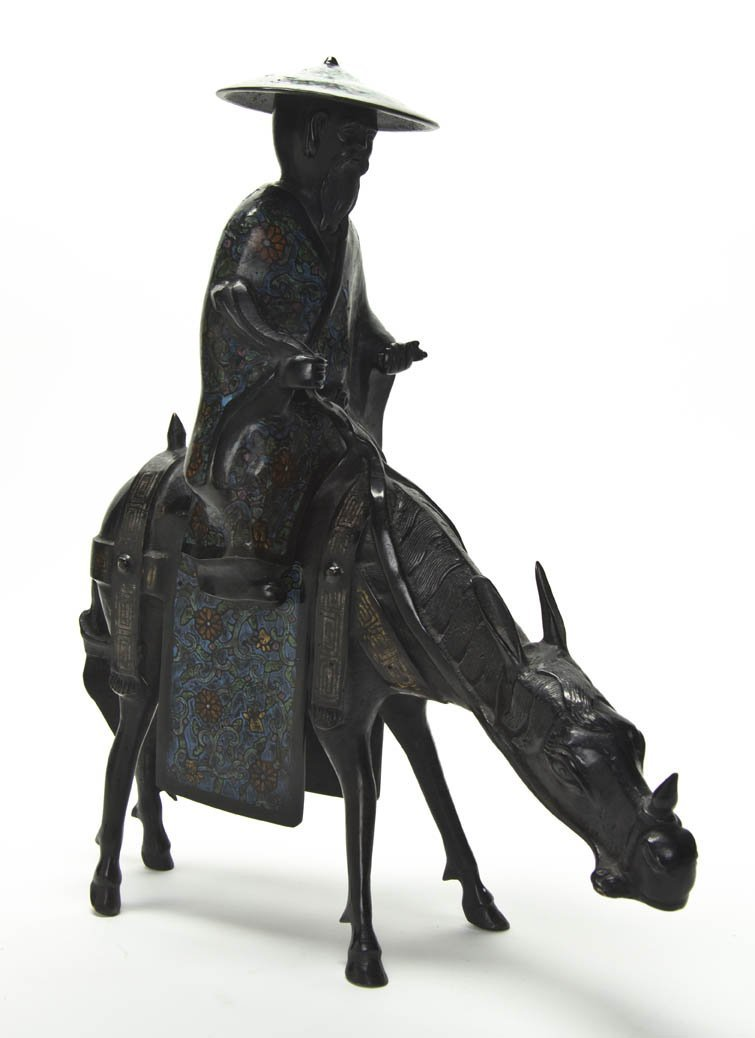 2617: A Bronze Model of a Figure on a Donkey, Height 18