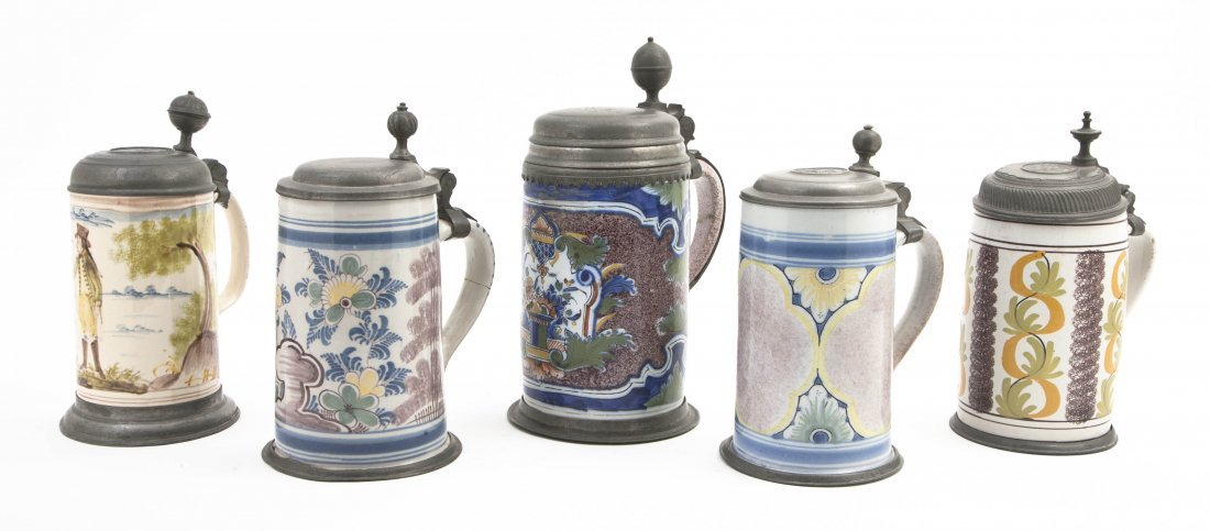 2159: A Collection of Five Pewter Mounted Faience Stein