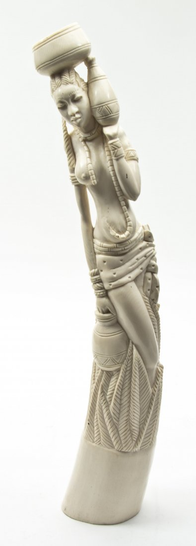 2435: An African Carved Ivory Tusk, Height 23 inches.