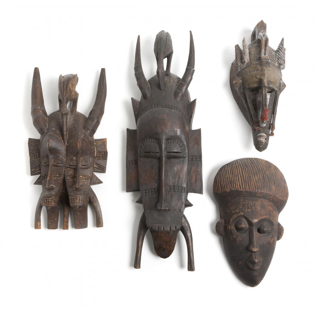 2438: Four African Carved Masks, Height of tallest 22 3