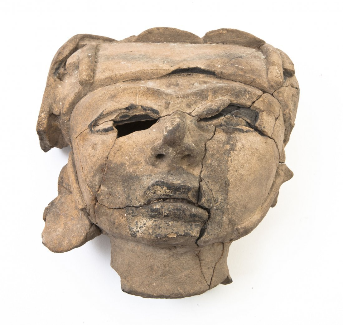 2442: An Olmec Style Pottery Mask, Height 7 1/4 inches.