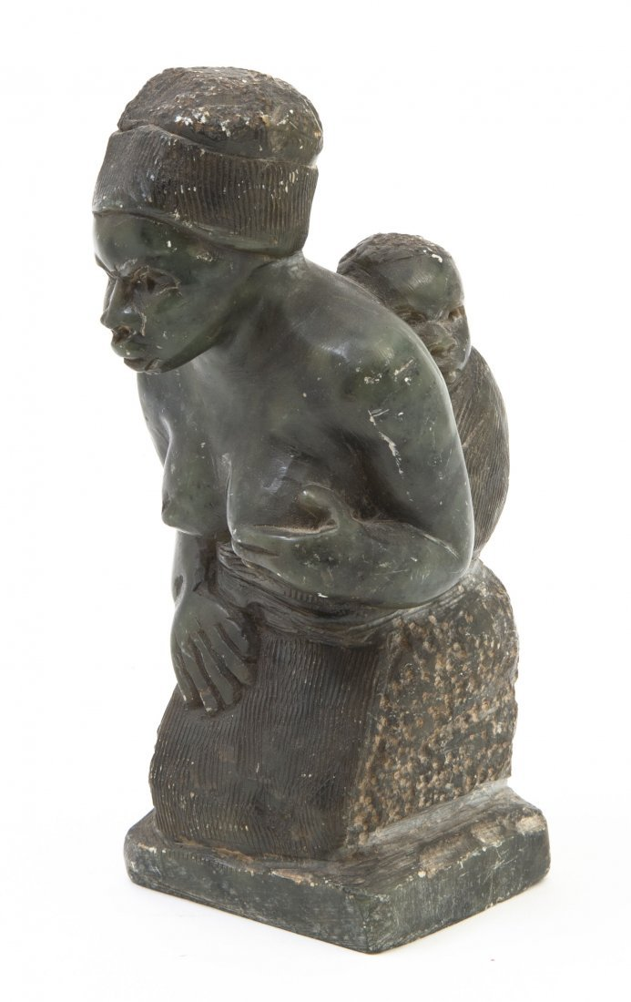 2445: An African Carved Stone Figure, Height 5 3/4 inch