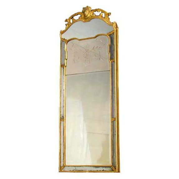 1: A French Régence Period Gilt and Etched Pier Mirror,