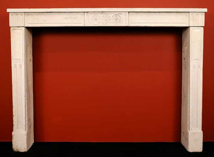 18: A French Louis XVI Limestone Fireplace Surround, He