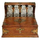 550 An English Victorian Brass Mounted Oak and Crystal