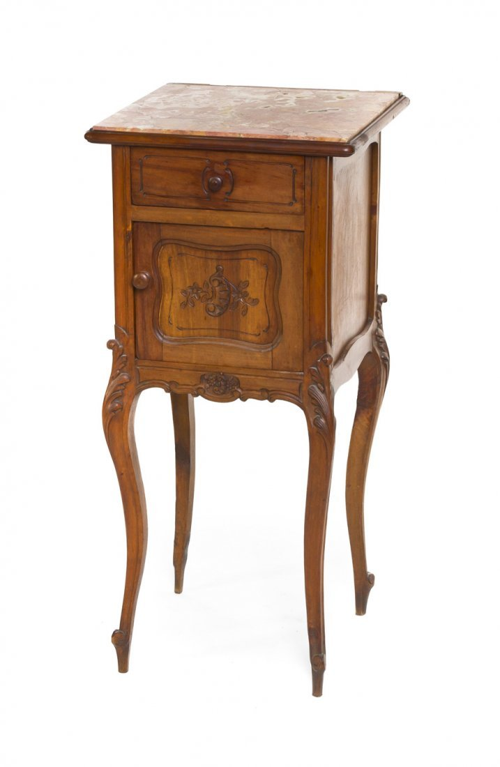 441: A Louis XV Provincial Style Walnut Cabinet on Stan