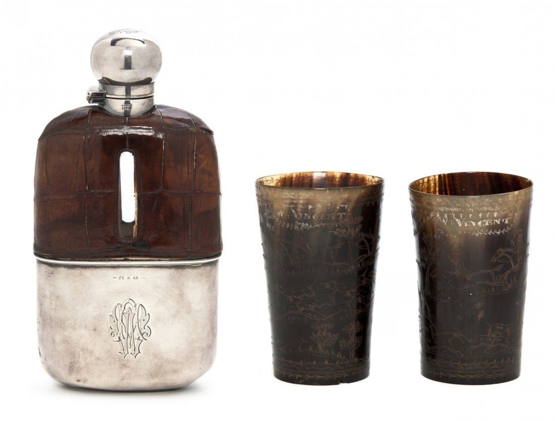 911: An English Silver and Leather Clad Drinking Flask,