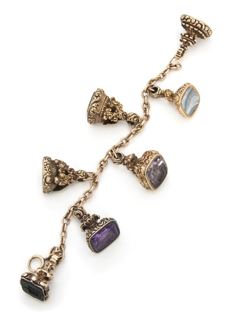 1073: A Collection of Seven Gilt Metal and Stone Fob Se
