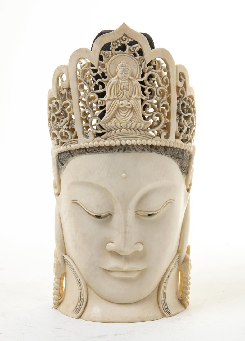 2874: A Chinese Carved Ivory Buddha Head, Height 8 3/16