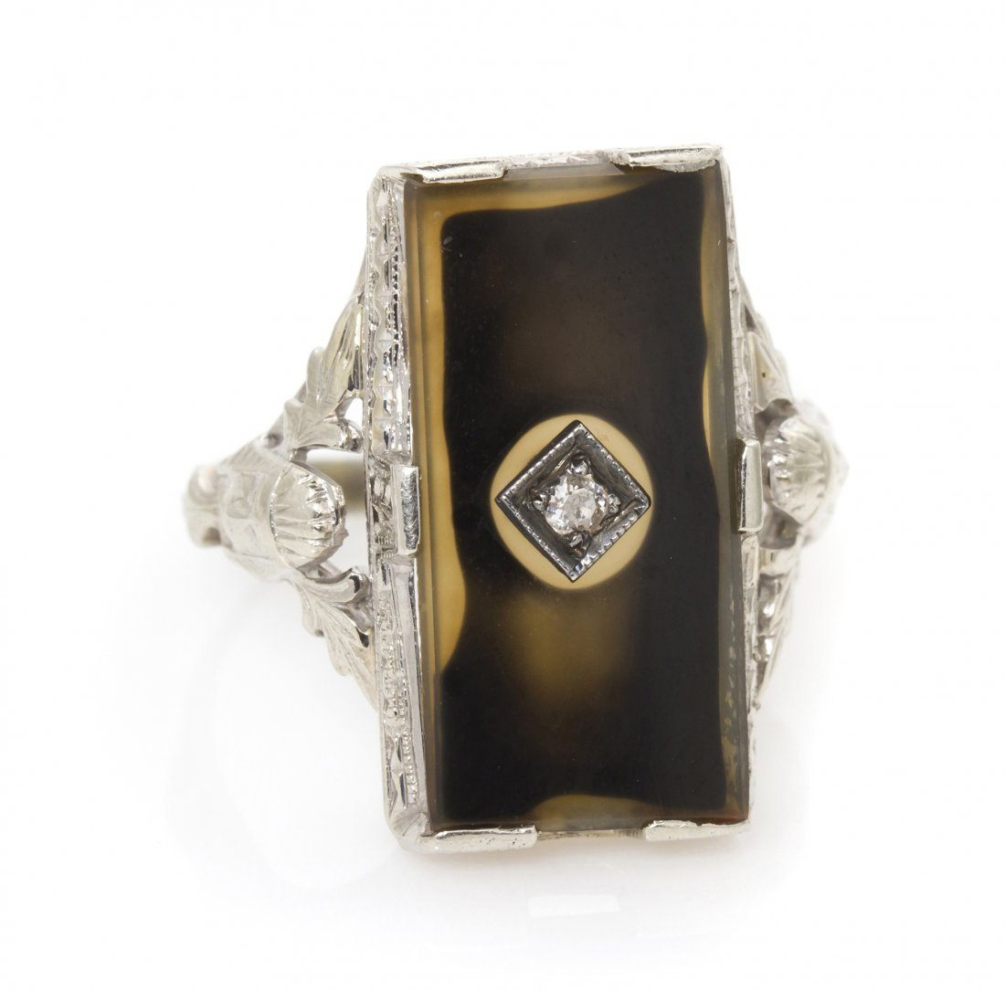 22: An 18 Karat White Gold, Agate and Diamond Ring in a