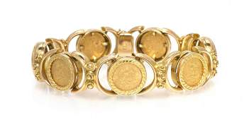 233: An 18 Karat Yellow Gold and Mexican Dos Pesos Gold