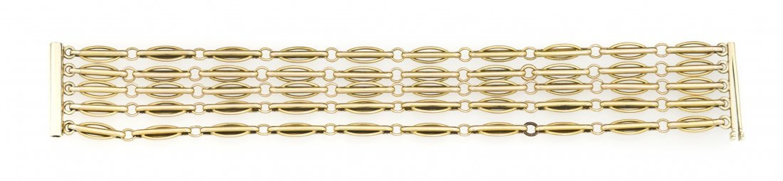 242: A 14 Karat Yellow Gold Five Strand Link Bracelet,
