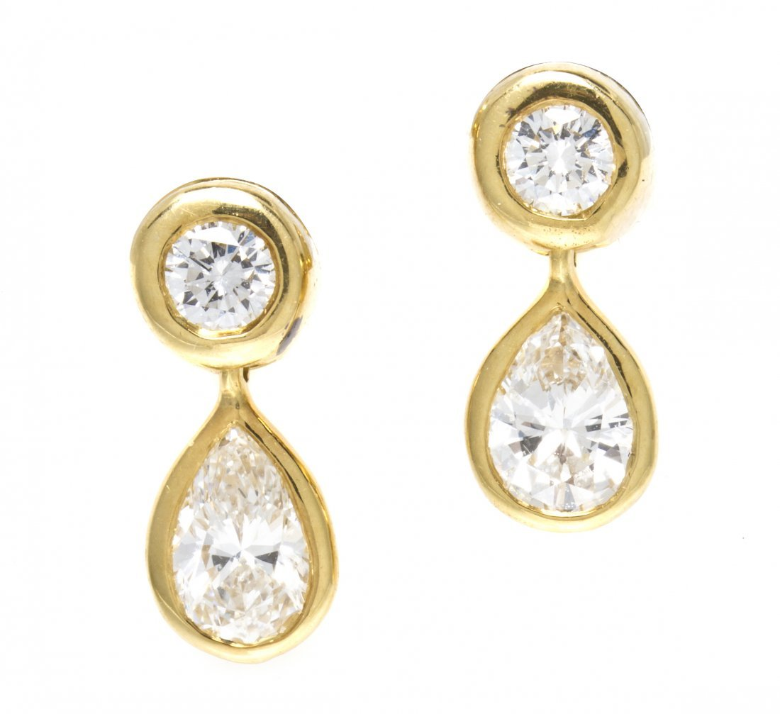 260: A Pair of 18 Karat Yellow Gold and Diamond Earring