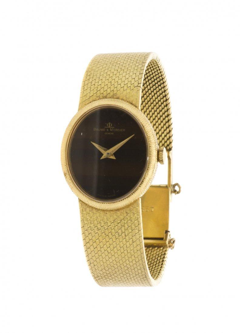 390: An 18 Karat Yellow Gold Wristwatch, Baume & Mercie