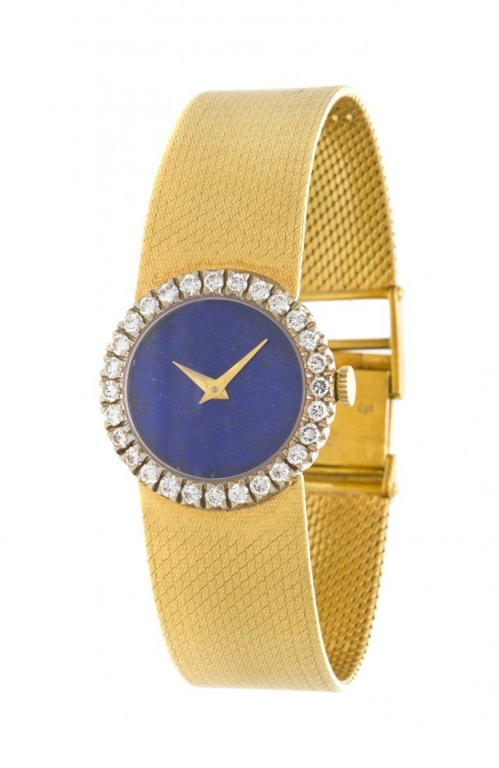 391: An 18 Karat Yellow Gold, Lapis Lazuli and Diamond