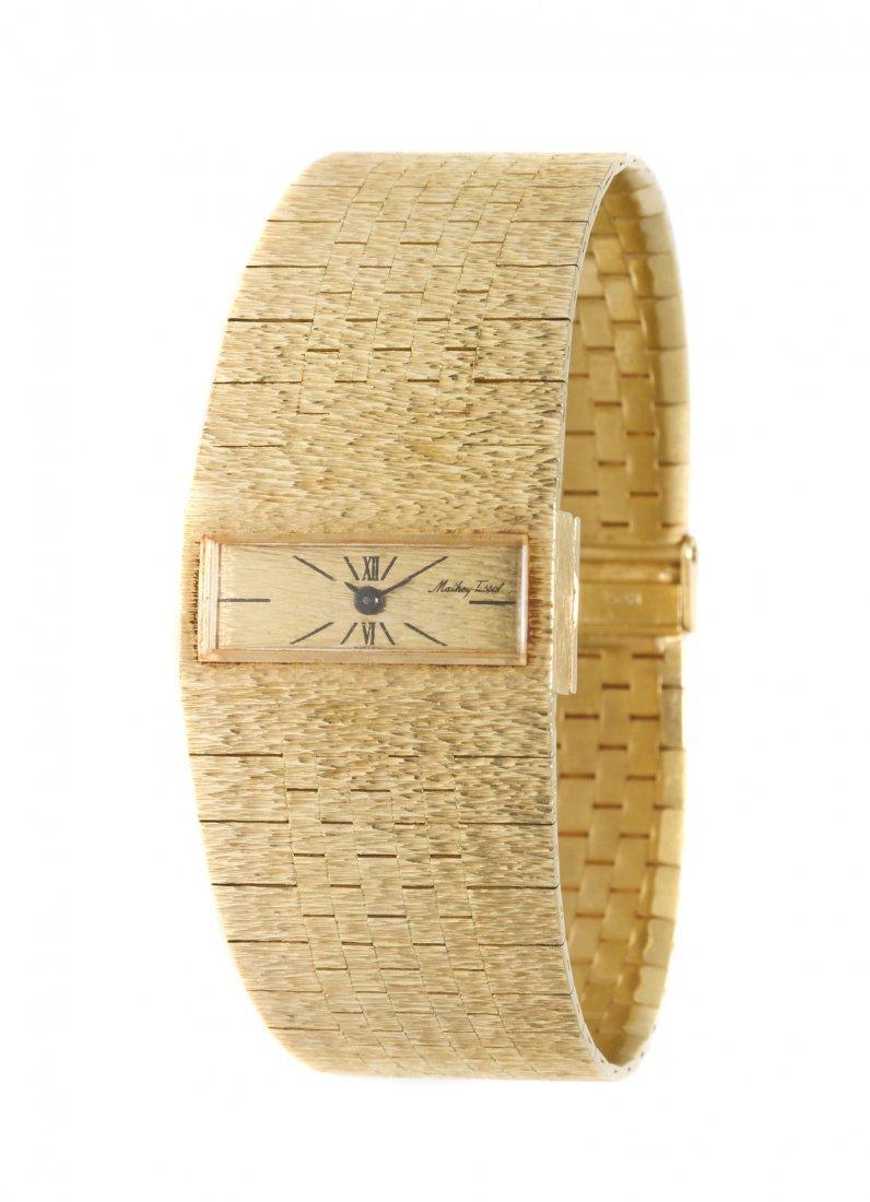 392: A 14 Karat Yellow Gold Wristwatch, Mathey Tissot,