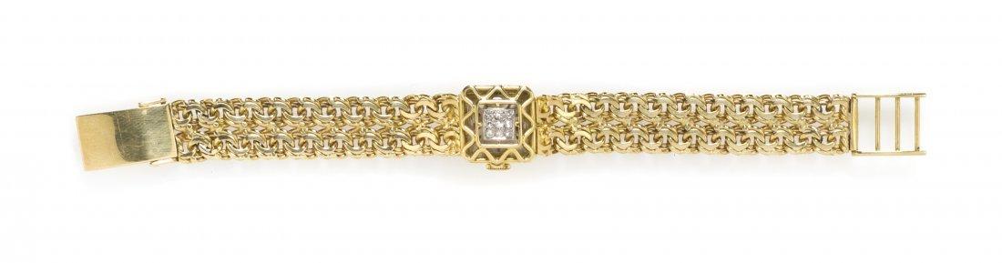 396: An 18 Karat Yellow Gold and Diamond Surprise Wrist
