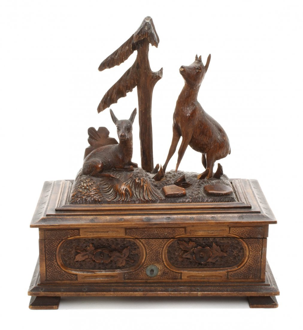 1: A Black Forest Carved Wood Music Box, Height 8 inche