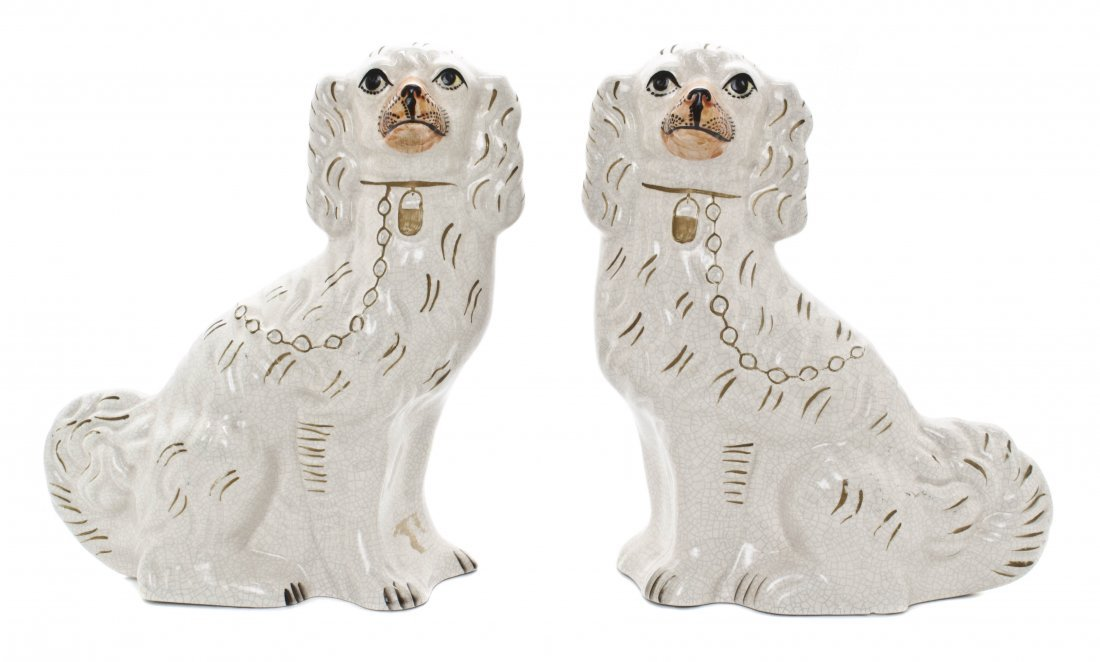 12: A Pair of Staffordshire Ceramic Spaniels, Height 13