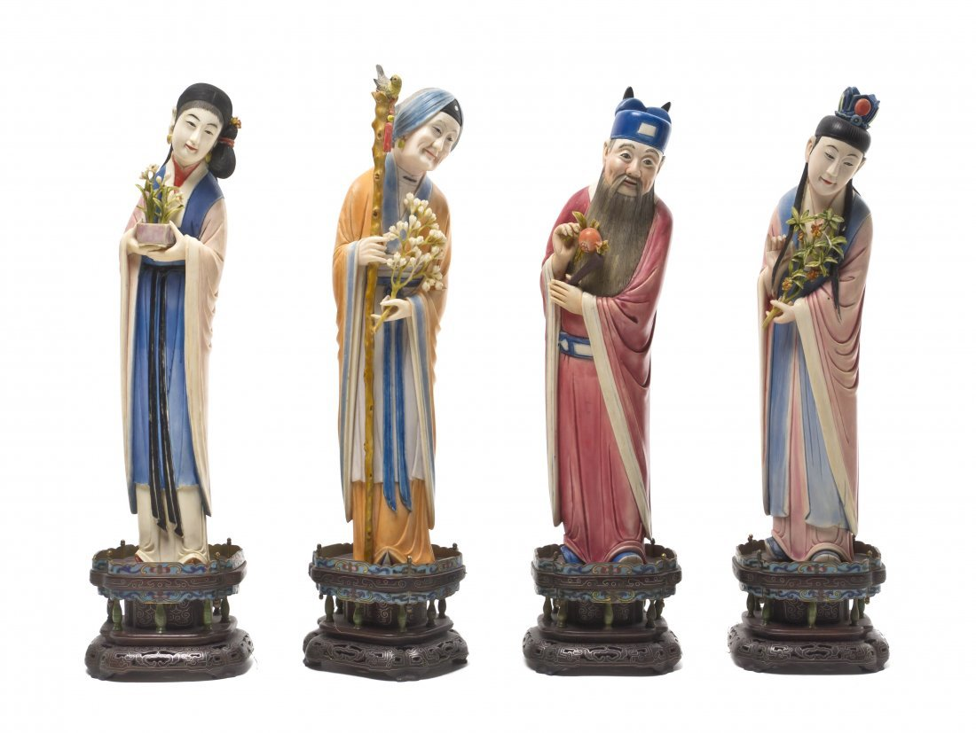 100: A Set of Four Chinese Polychrome Decorated Ivory F