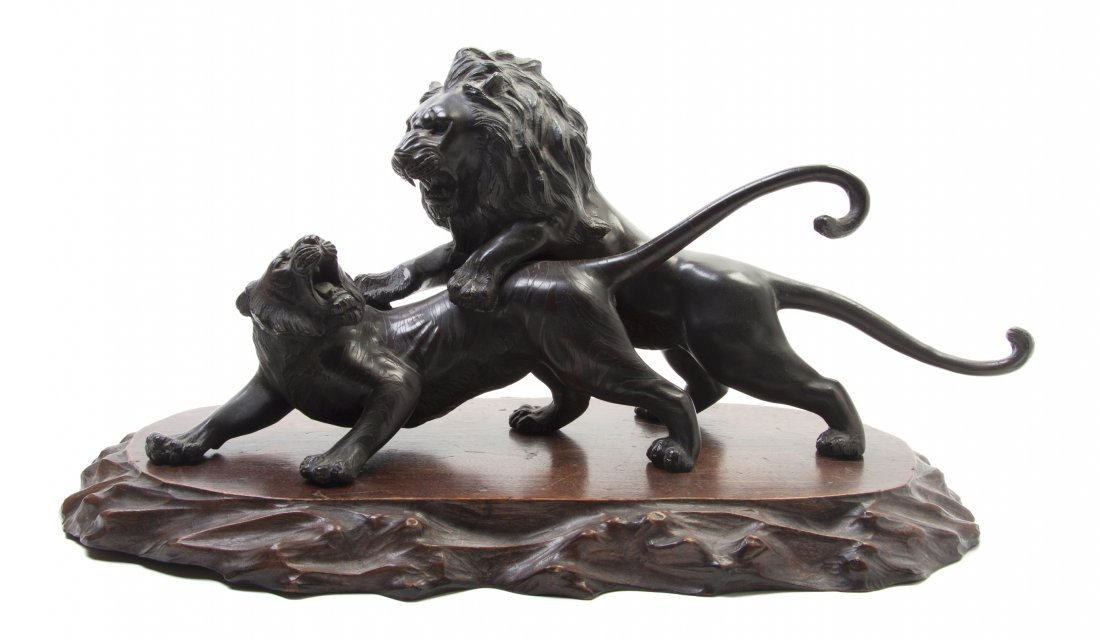 487: A Japanese Bronze Model of a Lion Attacking a Tige