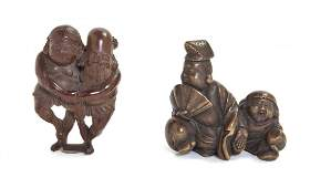 559 A Group of Two Carved Wood Netsuke Height of tall