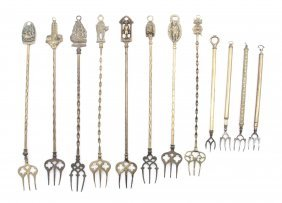 9: A Collection of Twelve English Brass Toasting Forks,