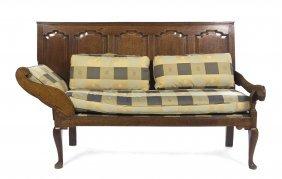 24: An English Oak Settle, Height 45 3/4 x width 72 5/8