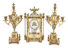 438: A French Gilt Brass and Champleve Clock Garniture,