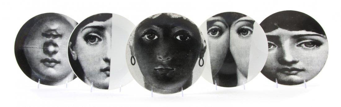 1063: A Set of Thirteen Fornasetti Face Plates, Diamete