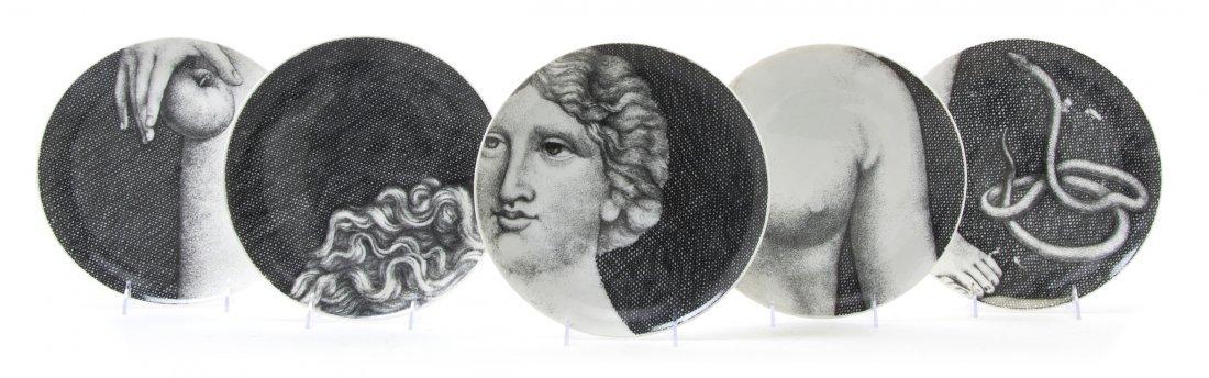 1064: A Set of Twelve Fornasetti Eve Plates, Diameter 1